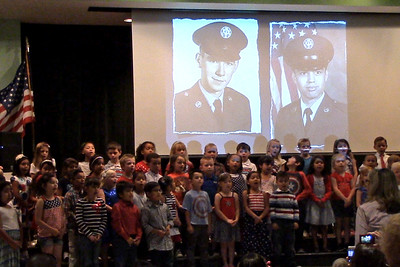 "Very special picture - as the kids were singing ""God Bless the USA"", there was a slide show with Joe's picture.  I was able to grab this shot from the video."