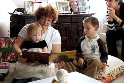 12-18-11:  Terry reading to Ashley and her cousin Bradley